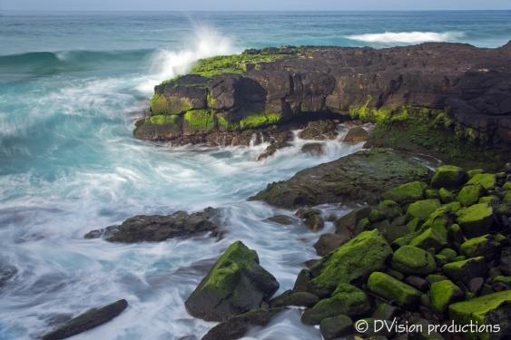 Surf breaking and swirling, Kauai north shore.